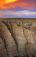 Fiery reds and oranges dominate the sunset over the Badlands National Park in South Dakota. - South Dakota Photograph