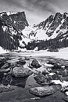 Snow and Ice still partially cover Dream Lake in Rocky Mountain National Park on a cold May morning. - Colorado Photograph