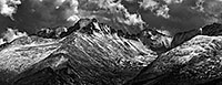 After a fresh covering of snow, Long's Peak emerges from the clouds after a storm over Rocky Mountain National Park. - Colorado Black and White Photograph