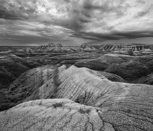 Rocks and formations under stormy skies in Badlands National Park, South Dakota. - South Dakota Photograph