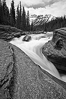 Water runs fast through Mistaya Canyon in the spring during the snow melt. - 777 Photograph