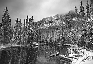During a light late spring snowfall the water is still and the surroundings quiet. - 777 Photograph