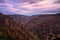 Pastel hues dominate the sky and are reflected throughout the canyon during a beautiful summer sunrise. - Colorado Landscape Photograph