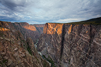 Sunlight illuminates the walls of the Black Canyon of the Gunnison just after sunrise. - Colorado Landscape Photograph