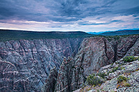Dusk descends on the Black Canyon of the Gunnison.  The cool blue hues began to prevail throughout the sky and are reflected in the canyon walls. - Colorado Photograph