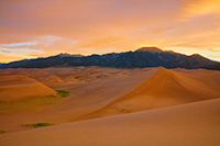 With no wind there is a complete silence on the dunes while the sunrise bathes the landscape in a warm glow a Great Sand Dunes National Park, Colorado. - Colorado Landscape Photograph