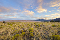 The sun rises over the Sangre De Cristo Range and the Great Sand Dunes. - Colorado Landscape Photograph