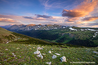 Clouds gather above the tops of the mountains in Rocky Mountain National Park as the last warm glow of sunset grazes the peaks. - Colorado Landscape Photograph