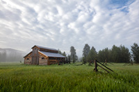 Fog rolls through the Kawuneeche Valley and surrounds this old rustic barn in Rocky Mountain National Park. - Colorado Landscape Photograph