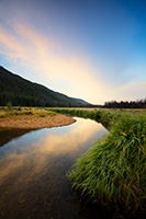 On the west side of Rocky Mountain National Park, the North Inlet stream snakes through a meadow and reflects a beautiful autumn sunrise. - Colorado Landscape Photograph
