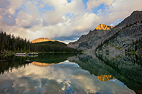 Mountains glow with the last light of a cool autumn day while an almost perfect reflection shimmers in Nanita Lake. - Colorado Landscape Photograph