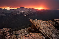 The sun shines brightly for one last minute before setting illuminating the clouds during a snowstorm at the Forest Canyon Overlook at Rocky Mountain National Park. - Colorado Photograph