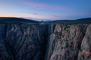As twilight descends into the Black Canyon of the Gunnison blue hues dominate the sky and the walls. - Colorado Landscape Photograph
