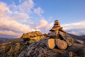 High up in Rocky Mountain National park a cairn stands witness to a beautiful morning across the tundra. - Colorado Landscape Photograph