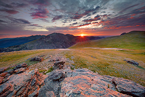 A photograph of a beautiful sunset on the tundra landscape of Rocky Mountain National Park in Colorado. - Colorado Landscape Photograph