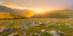 A landscape photograph of a beautiful sunset on the tundra of Rocky Mountain National Park in Colorado. - Colorado Landscape Photograph