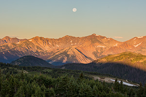 Landscape scenic photograph of the moon setting over the Never Summer Mountain Range, Rocky Mountain. - Colorado Landscape Photograph