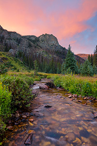 A scenic photograph of Tonahutu creek and a sunset at Rocky Moutain National Park, Colorado. - Colorado Landscape Photograph