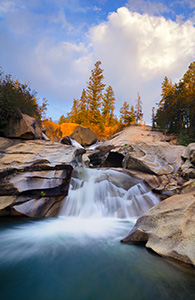The soothing swoosh of the waterfall was the other sound as the warm last light strikes trees above the Grottos Waterfall in the White River National Forest in Colorado. - Colorado Landscape Photograph