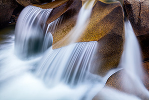 Water has smoothed the surface after thousands of years, constantly flowing across these rocks creating a unique pattern.  Grottos Waterfall in the White River National Forest in Colorado. - Colorado Landscape Photograph