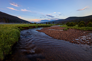 The head of the Colorado River runs through the Kawuneeche Valley in western Rocky Mountain National Park.  Here it is a quiet stream that is quite easy to across, much different than the raging river found at the bottom of the Grand Canyon. - Colorado Landscape Photograph Photograph