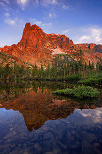 I had first hiked to Lake Helene about 5 years prior on a crisp fall day and on that visit became one of my favorite locations in Rocky Mountain National Park.  I took another opportunity to visit this scenic location, this time in the summer.  As the sun rose, Notchtop glowed with a brilliant warmth similar to what I had witnessed on the prior visit.  This year, however, the water was calm and reflected the beautiful scene that was before me. - Colorado Photograph