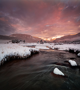 On a cold day in mid-May, the Big Thompson flows through Moraine Park as the first sunlight of the day illuminates the peaks of the Continential Divide. - Colorado Landscape Photograph