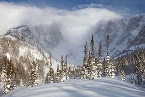 Hallet and Flattop are partially hidden by the blowing snow and clouds due to a large mid-May snowfall. - Colorado Landscape Photograph