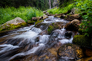 Scenic landscape photograph of cascades found just below Fourth Lake in the backcountry of Rocky Mountain. - Colorado Photograph