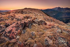 On this day, as many days through time, the exposed rocks on the tundra area of Rocky Mountain National Park bear witness to the rising sun and its illumination of Longs Peak. - Colorado Photograph