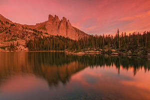 The warmth of a summer sunrise bathes Lake Nanita and Ptarmigan Mountain in a warm red glow. - Colorado Landscape Photograph Photograph