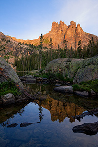 The summer sun shines a warm glow on Ptarmigan Mountain it's reflection in an outlet of Lake Nanita below. - Colorado Landscape Photograph Photograph