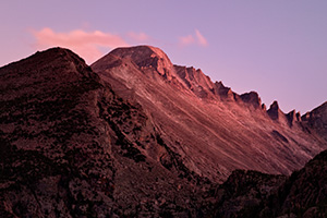 The last light of sunset emblazens Long's Peak with a crimson hue before dimming into night. - Colorado Photograph