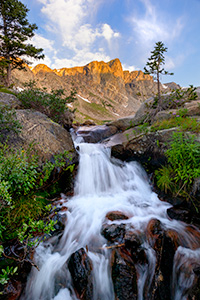 A scenic landscape photograph of a waterfall below Mirror Lake in the Rocky Mountain National Park, Colorado. - Colorado Photograph