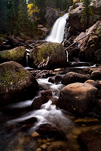 A popular hiking destination, Alberta falls at Rocky Mountain National Park roars downhill. - Colorado Photograph