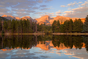 During a cool October sunrise the peaks of the continental divide, Powell Peak, Taylor Peak, Otis Peak, Hallett Peak, and Flattop Mountain are reflected in the calm waters of Sprague lake. - Colorado Photograph