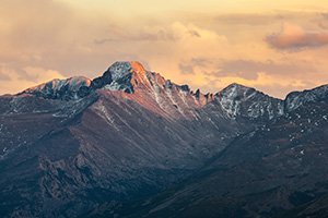 Long's Peak's western face glows with the last warm hues of sunset. - Colorado Photograph