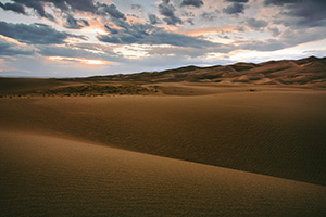 Near sunset the dunes appear to go to infinity. - Colorado Photograph