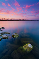 Quiet.  Peaceful.  The day ends with pink clouds and a purplish sky in the distance.  All is quiet save for the rustling of the nearby cottonwoods from a gentle easterly breeze.  This is my favorite time of the day, the time when shadows grow long and colors vivid. - Nebraska Landscape Photograph