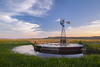On a breezy evening in Crescent Lake National Wildlife Refuge a windmill stands like a sentinel among the sandhills. - Nebraska Nature Photograph