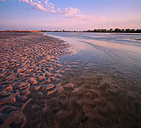 On a sandbar near Two Rivers State Recreation Area, the Platte River flows into the distance as the sun sets to the west. - Nebraska Photograph