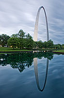 The Gateway Arch and its reflection at the Jefferson National Expansion Memorial in St. Louis, Missouri.  In 1980, Kenneth Swyers tried to parachute onto the Gateway Arch, he succeeded in reaching the structure, however, he failed in his subsequent base jump attempt, sliding down one side to his death.  - Missouri Photograph