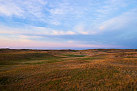 The last light of Day illuminates a windmill nestled in the sandhills on the western edge of Halsey National Forest. - Nebraska Photograph