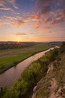 The Niobrara is one of the most popular rivers for canoeing and tubing in the United States.  On a beautiful spring sunrise, the river lazily meanders into the east as the sun rises in the distance. - Nebraska Photograph