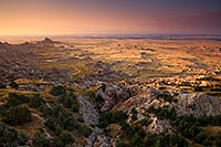 One of my favorite hikes in the Badlands is the Notch trail.  Not for those who fear heights, to take this trail you must ascend a ladder and then climb above a canyon.  From the notch, the first light of day illuminates the unique landscape of the Badlands National Park in South Dakota. - South Dakota Landscape Photograph Photograph