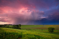 A fierce midwestern storm filled with lightning, moves quickly east across the Nebraska plains into Iowa. - Nebraska Photograph