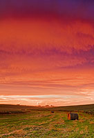 After an intense Midwestern storm, beautiful color is reflected in the clouds. - 777 Photograph