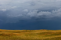 Dark clouds hover over the rolling sandhills in McKelvie National Forest. The darkness on the horizon all but extinguished the light of day on a previously sunny afternoon. I knew that beyond the dark clouds, however, the sky was still blue. - Nebraska Photograph