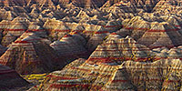 A section of the Badlands in South Dakota glow with the warmth of the pre-risen sun. - South Dakota Photograph
