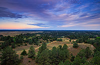 Clouds roll over Halsey National Forest in the central Nebraska.  From the Scott Tower lookout the largest handplanted forest in the United States extends into the distance. - Nebraska Photograph
